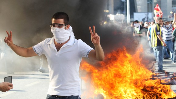 A protester flashes a victory sign as he takes part in a demonstration in Ankara on Saturday, June 1 in support of the protests in Istanbul against  government plans to demolish a park.