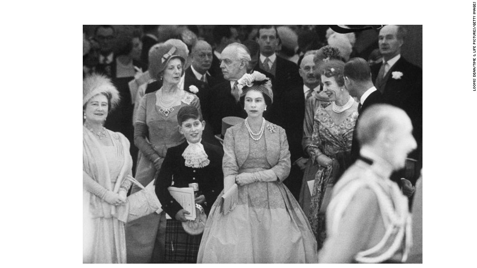 Queen Mother Elizabeth, from left, Prince Charles and Queen Elizabeth II attend Princess Margaret's wedding in 1960.