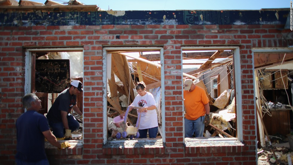 Dustin Horn, second from left, helps his parents, JoAnn and Fred Horn, salvage items from their home on June 2, two days after a tornado ripped through El Reno, Oklahoma.