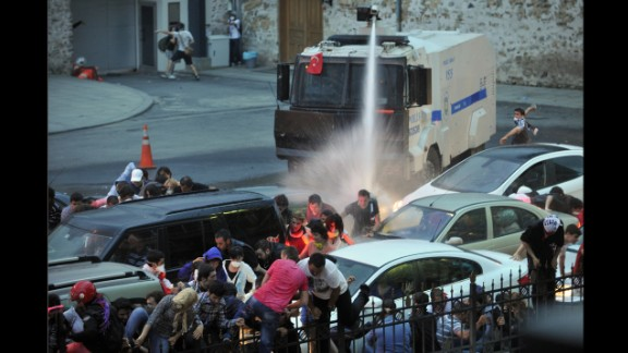 Police use a water cannon to disperse protesters outside Turkish Prime Minister Recep Tayyip Erdogan