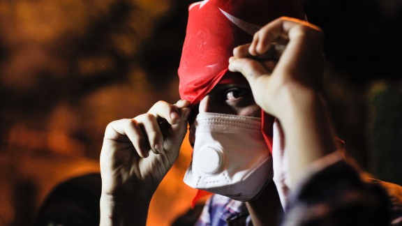 A protester covers his face on June 3 near Erdogan