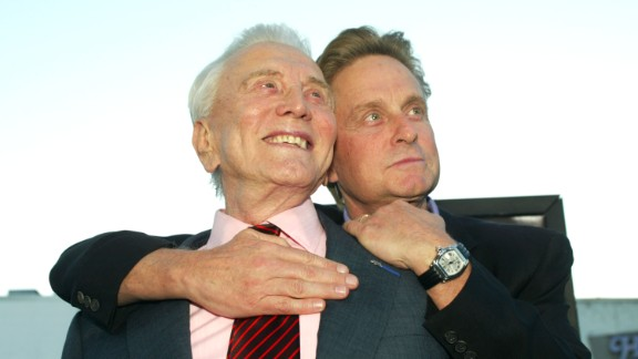 """At the premiere of """"It Runs In The Family,"""" in  April 2003, Douglas and his father, actor Kirk Douglas, left, embrace at the Bruin Theater in Los Angeles."""