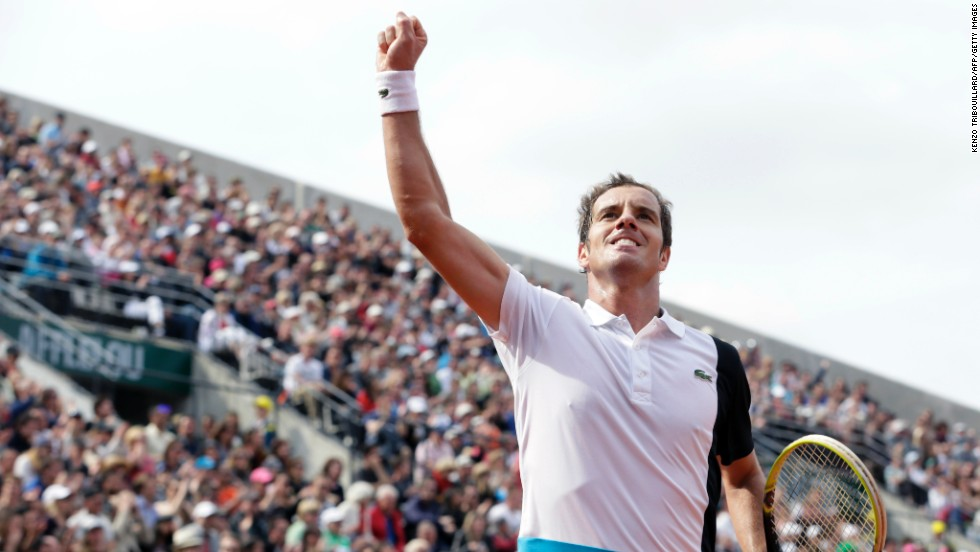 After winning a second set against Switzerland's Stanislas Wawrinka, France's Richard Gasquet celebrates at the French Open on June 3.