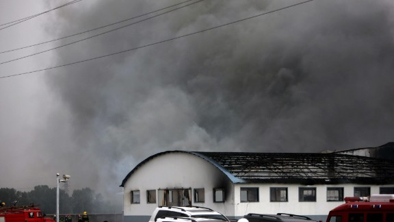 Smoke billows from a large poultry processing plant in Mishazi Township of Dehui City in northeast China's Jilin Province on Monday, June 3. More than 300 workers were inside the plant when the fire broke out about 6 a.m., the state-run Xinhua news agency said. More than 100 people were reported killed in the fire.