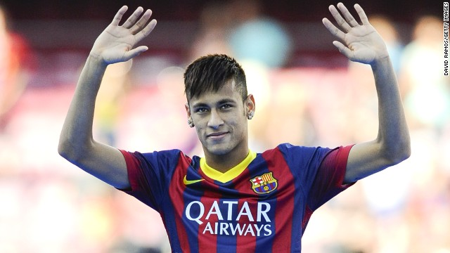 Neymar waves to a packed Nou Camp on the day he officially became a Barcelona player