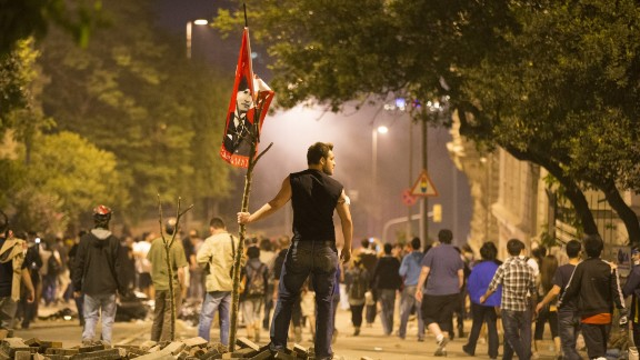 A protester looks on during clashes with Turkish police outside of Prime Minister Recep Tayyip Erdogan