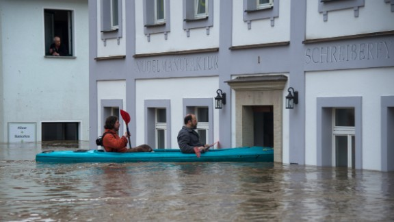 People canoe in the flooded city of Wehlen, Germany, on June 4.