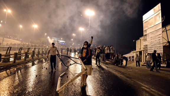 Protesters clash with riot police between Taksim and Besiktas in Istanbul on Monday, June 3.