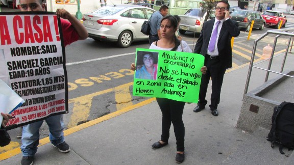 What happened to 12 young people who were forced at gunpoint into a van in Mexico City's popular Zona Rosa entertainment district on May 26? The mystery has gripped nation. Penelope Ramirez is a cousin of Jerzy Ortiz Ponce, who is one of the 12 missing people. She holds a sign with his picture during a gathering of family members in the Tepito area of Mexico City on May 31.