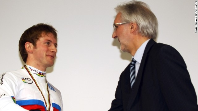 Brian Cookson congratulates Britain's Olympic sprint champion Jason Kenny at an awards ceremony.