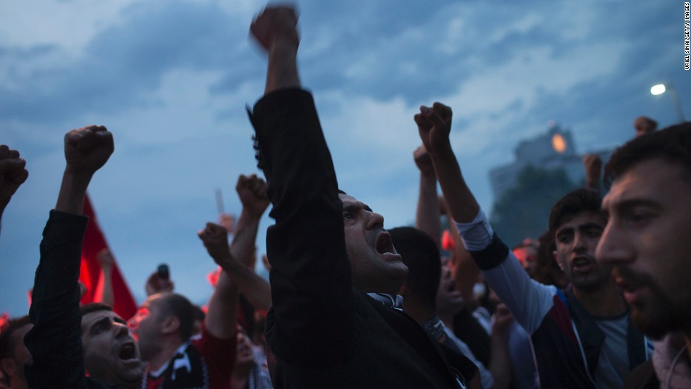 Protesters gather in Taksim Square as they shout slogans while protesting on Tuesday, June 4, in Istanbul, Turkey.