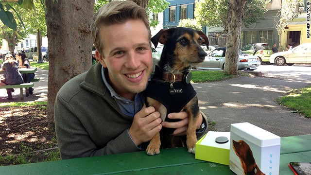 Whistle co-founder and CEO Ben Jacobs and beta tester Duke, who is modeling the company's new pet activity tracker.