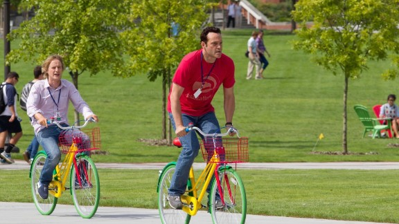 """This scene with Wilson, left, and Vaughn reflects Google's famous bicycle culture. The company keeps some 1,300 bikes at its Mountain View campus -- about one for every five employees -- including multicolored models dubbed """"clown"""" bikes."""