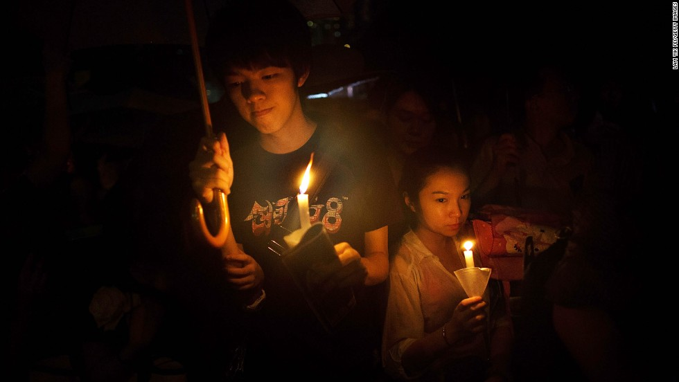 "JUNE 5 - HONG KONG - People hold a candlelight vigil to mark the anniversary of the crackdown on the pro-democracy movement in Beijing's Tiananmen Square on June 4, 1989. Pro-democracy groups around the world say the <a href=""http://cnn.com/video/?/video/world/2013/06/03/nr-intv-rife-amnesty-intl-on-china.cnn"">human rights struggle continues in China</a>."