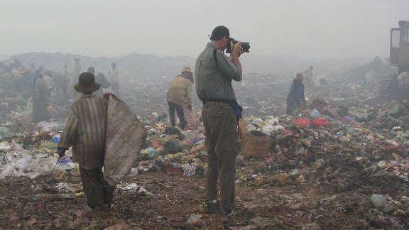 """Haunted by what he saw at the dump, Bill Smith started taking photos. """"I remember thinking, 'I got to take pictures as fast as I can to show people this,' """" the professional photographer recalls."""