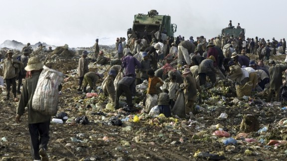 Hundreds scavenge through garbage at the Stung Meanchey dump outside Phnom Penh, Cambodia. Photographer Bill Smith and his wife, Lauren, said they were shocked by what they saw on a 2002 trip.