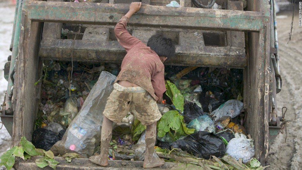A child picks through garbage instead of going to school. Many families depend on the money the children make at the dump, about $10 a month, according to Bill Smith.