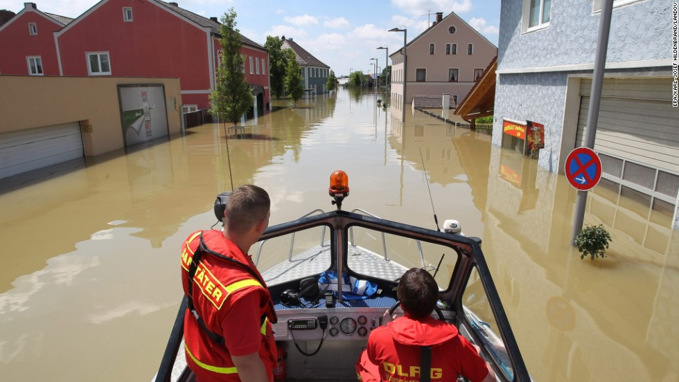 German Lifesaving Society workers drive through the flooded area of Deggendorf, Germany, on June 5.