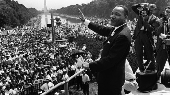 The Rev. Martin Luther King Jr. waves to supporters on the Mall in Washington during the March on Washington on August 28, 1963.