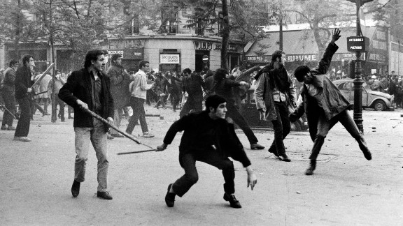 Students in Paris hurl projectiles at the police on Boulevard Saint-Germain during the uprisings of May 6, 1968.