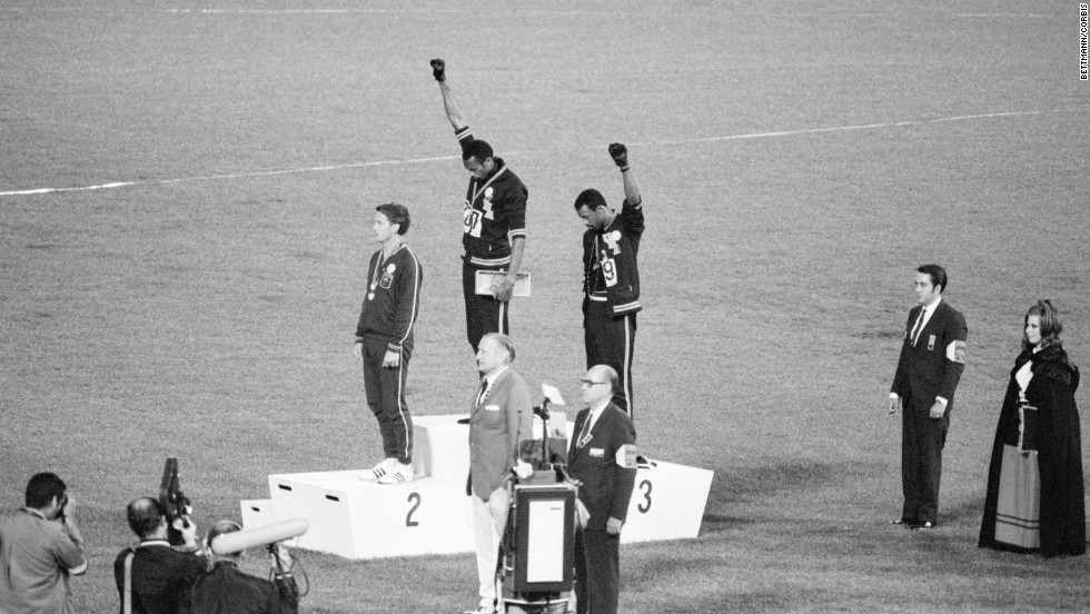 Tommie Smith and John Carlos, gold and bronze medalists in the 200-meter run at the 1968 Olympic Games, raise their fists in the Black Power salute on October 16, 1968, in Mexico City.