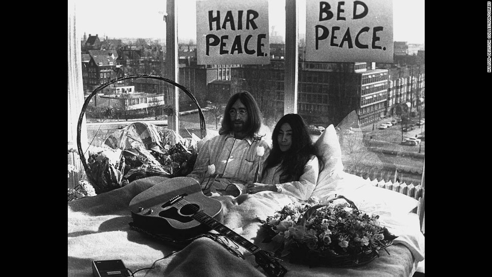 "John Lennon and Yoko Ono give a press conference during their ""bed-in"" for peace at an Amsterdam hotel in March 1969."