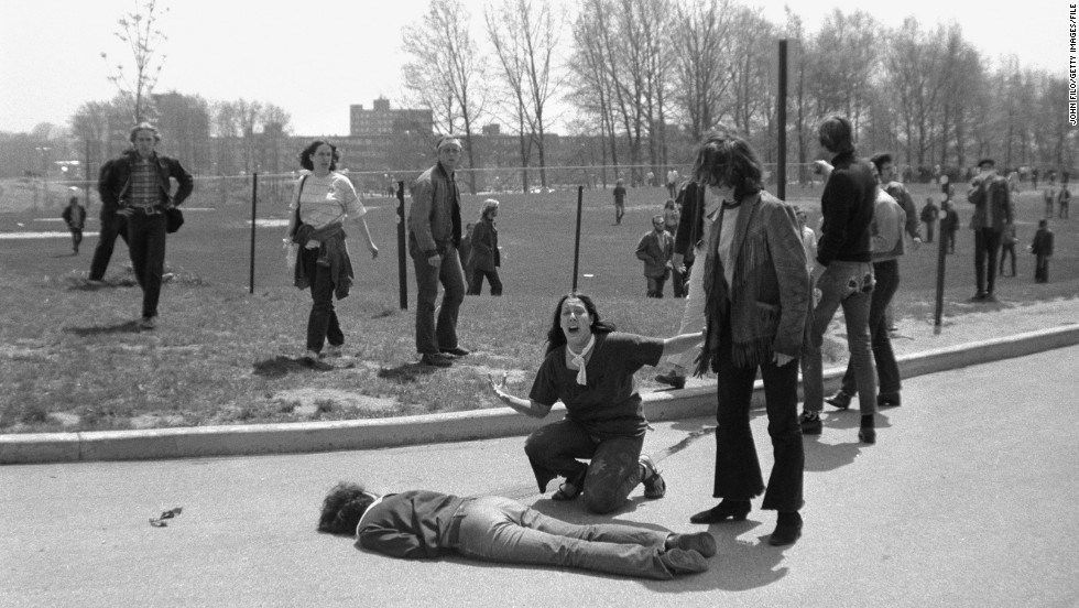 Mary Ann Vecchio kneels over the body of student Jeffrey Miller during an anti-war demonstration at Kent State University in Ohio on May 4, 1970.