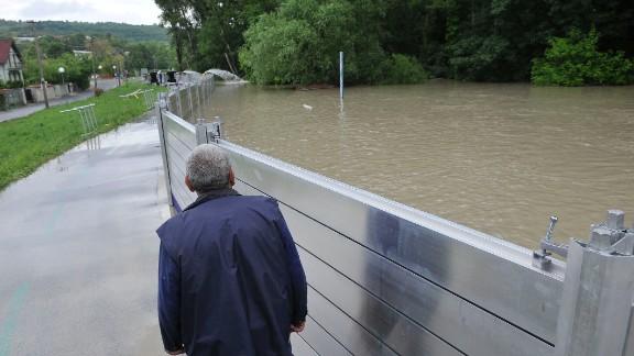 A man walks near a flood protection wall in Bratislavas, Slovakia, on June 5.