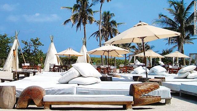 Beach club in palm swinging