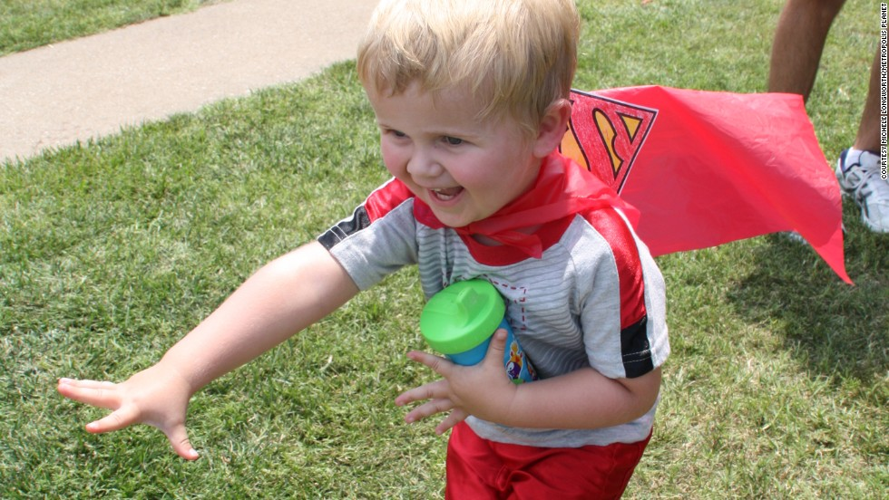 Kids make their own supercapes during the Make a Cape event, which invariably give them the ability to fly, albeit at very low altitude.