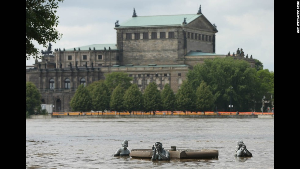 Elbe River floodwaters rise over statues across from the Semper Opera House in Dresden, Germany, on June 6.