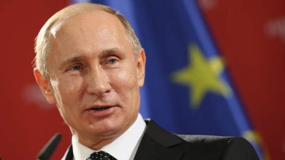 Putin addresses the media during his visit to Hanover.