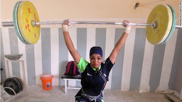 Rising to the challenge: A member of Iraq's first national female weightlifting team.