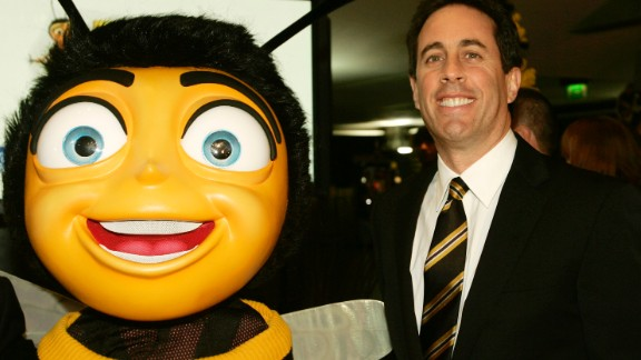 """Jerry Seinfeld appears with a giant, costumed bee for a premiere of his film """"Bee Movie"""" in November 2007 in Brussels, Belgium."""