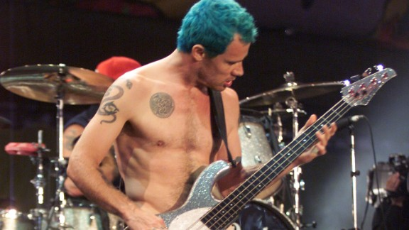 Red Hot Chili Peppers bassist Flea, whose real name is Michael Balzary, performs nude at Woodstock '99, a summer musical held in Rome, New York, as a tribute to its 1969 namesake.