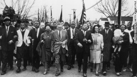 1965: Martin Luther King and his wife Coretta Scott King lead a voting rights march from Selma, Alabama, to the state capital in Montgomery.