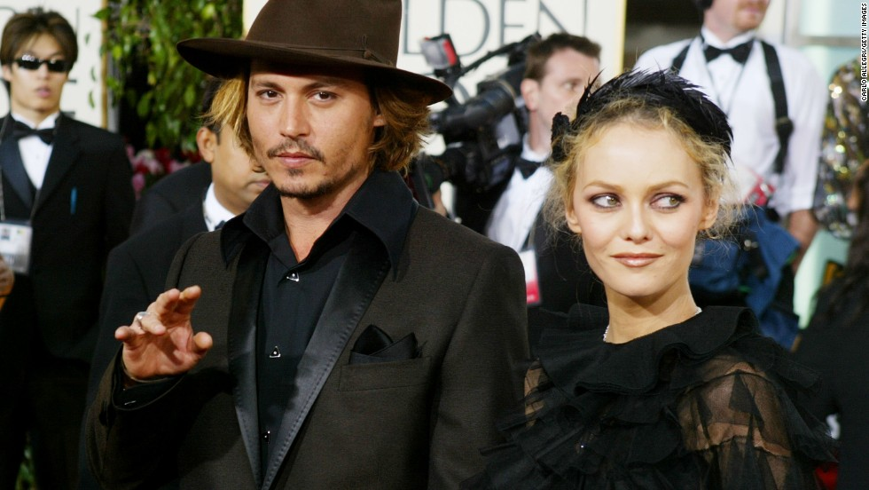 "Depp began dating French singer, model and actress Vanessa Paradis in 1994. The couple went on to have two children, Lily-Rose and Jack. Though they officially<a href=""http://www.people.com/people/article/0,,20562667,00.html"" target=""_blank""> split</a> last year, here is the couple during happier times at the Golden Globe awards in 2004."