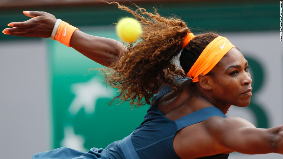Williams returns a shot to Sharapova on June 8.