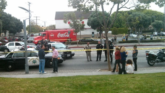 iReporter Nathaniel Westveer photographed the chaotic scene right outside his office building, which is 100 feet away from the crime scene at Santa Monica College. He says during the shooting, police closed down the intersection as they combed the adjacent office complex with their guns drawn.