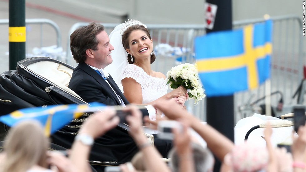 Christopher O'Neill and Princess Madeleine of Sweden are taken by horse and carriage from the Royal Palace of Stockholm to Riddarholmen after the wedding.