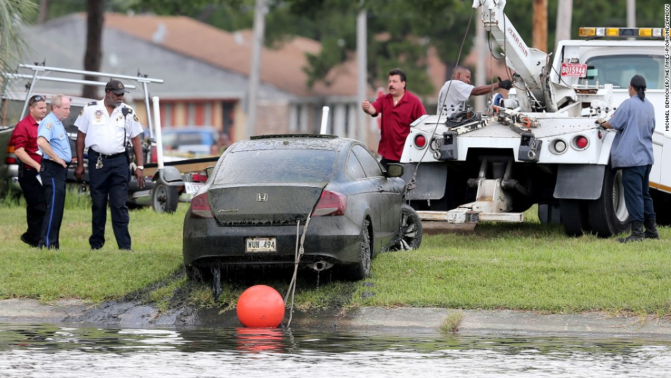 A tow truck pulls a car, identified as belonging to missing teacher, Terrilynn Monette, from Bayou St. John near the Harrison Avenue bridge in New Orleans, Louisiana, on Saturday, June 8, 2013. Monnette has been missing since she disappeared on March 2.