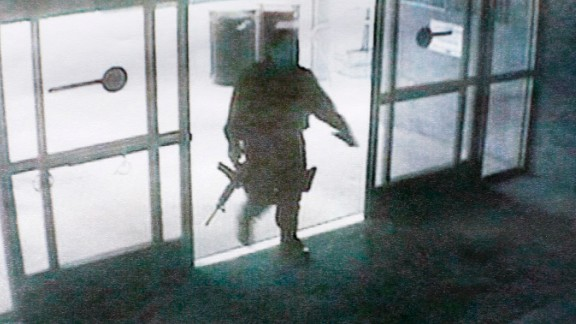 This photo, released by the Santa Monica Police department, shows the gunman entering the Santa Monica College library on June 7.  The gunman