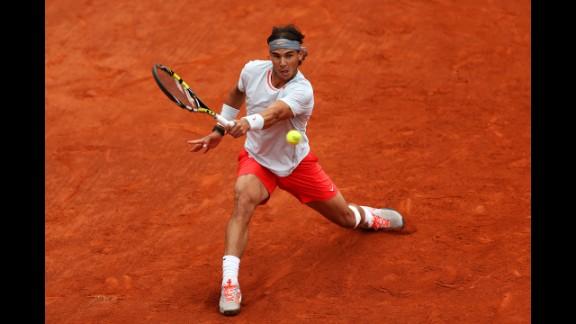 Nadal plays a backhand against Ferrer.