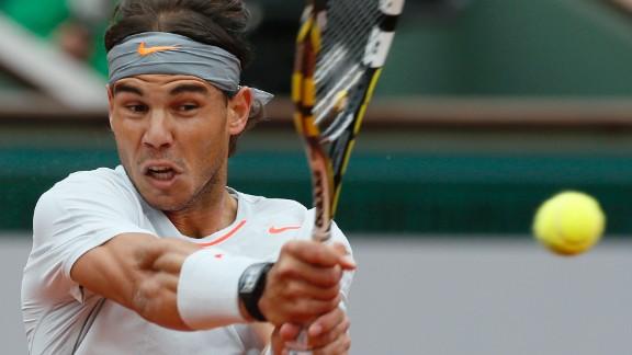 Nadal returns to Ferrer.