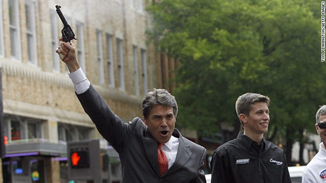 Texas Gov. Rick Perry fires a six-shooter.