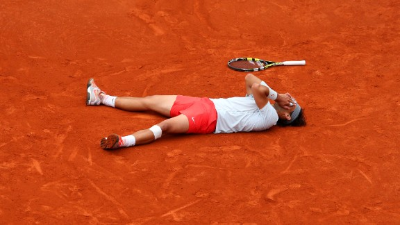 Rafael Nadal of Spain reacts after winning match point against David Ferrer of Spain during the men's singles final match of the French Open at Roland Garros Stadium in Paris, on Sunday, June 9. Nadal won 6-3, 6-2, 6-3.