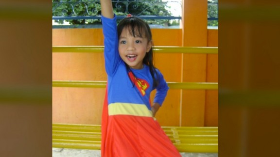 "Socrates Ballais photographed his daughter, Iyah, dressed as ""Supergirl"" for a school presentation. Both he and his daughter are huge superhero fans.  When Iyah wears the Superman cape, she believes she really has superpowers. ""She has no fear of heights, and thinks she is as powerful as Superman. I keep on reminding her that acting like Supergirl is just like a pretend play. She does not believe it,"" he said. ""I had to make sure that I am around when she dons the Supergirl attire."""