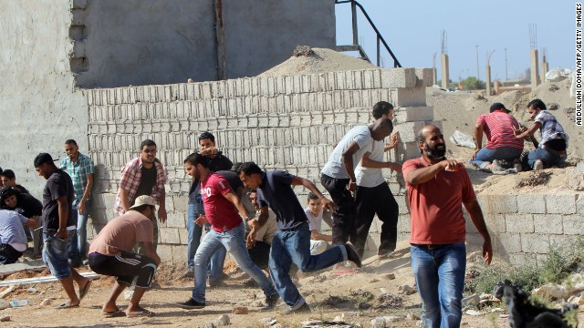 Libyan protesters are pictured during clashes with the Libyan Shield brigade on Saturday.