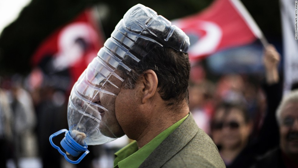 A demonstrator covers his face with a makeshift gas mask during protests in Kizilay Square in Ankara on June 9.