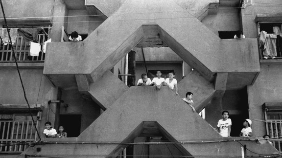 Archive photograph from the 1960s shows children playing in the stairways of the apartment blocks. At that time the population density on the island was among the highest in the world.